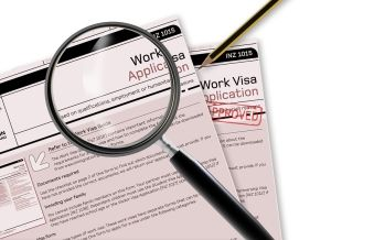 Magnifying Glass on Work Visa Application
